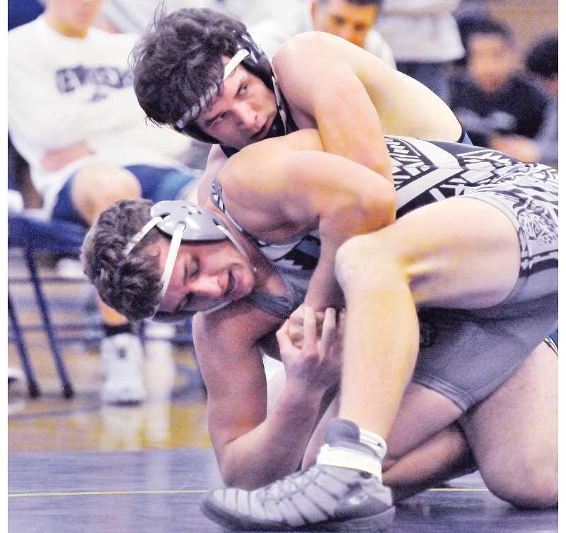 GARY ALLEN - Junior Hunter James controls his opponent during a dual meet against Century on Jan. 24. The Tigers won 61-15.