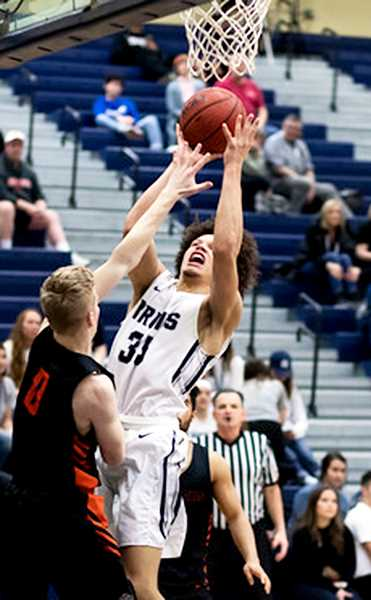 PHOTO COURTESY OF GFU - Senior forward Dylan Hamlett attacks the rim in GFU's 94-84 loss to Lewis & Clark on Saturday.