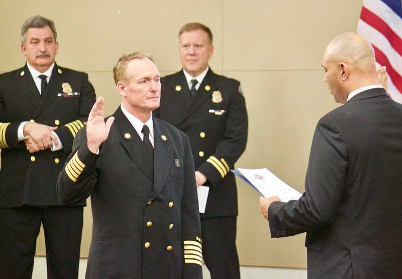 STAFF  PHOTO: CHRISTOPHER KEIZUR - Fire Chief Mitch Snyder was sworn-in during the 2018 Gresham Fire and Emergency Services Awards Ceremony on Friday, Jan. 25.