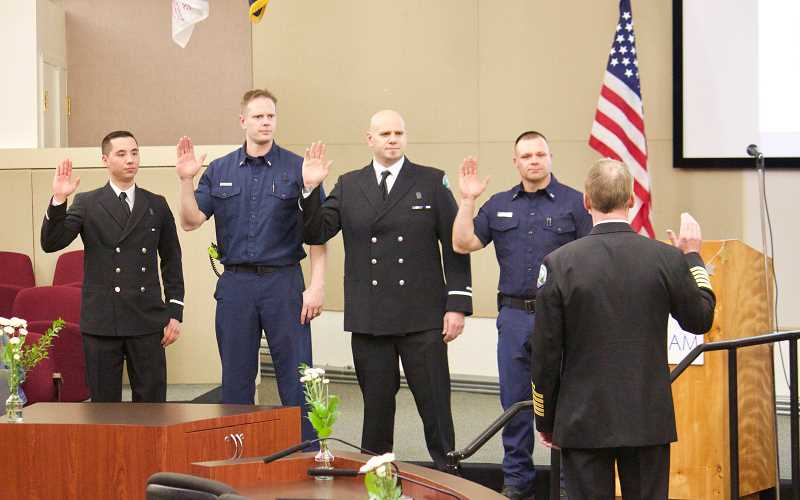 STAFF PHOTO: CHRISTOPHER KEIZUR - From left, Kestin Kim-Proudfoot, Ray Kellstrom, Tim Habeck and Jake Fish were all promoted to Lieutenant.