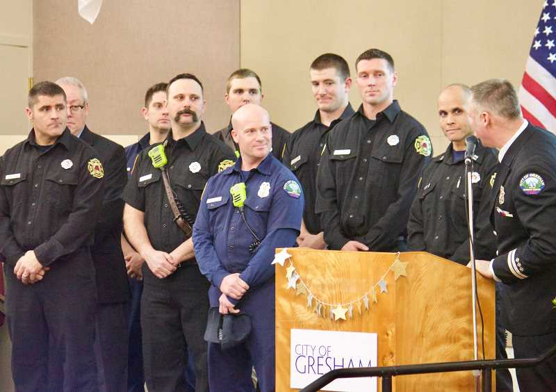 STAFF PHOTO: CHRISTOPHER KEIZUR - A large group of Portland and Gresham firefighters received the Special Unit Citation Award during the ceremony for their efforts in resuscitating and saving a newborn baby.