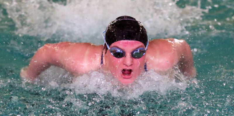 TIMES PHOTO: DAN BROOD - Tigard High School senior Kaitlyn Wornath swam to victory in the 100 butterfly event during last week's meet with Lake Oswego.