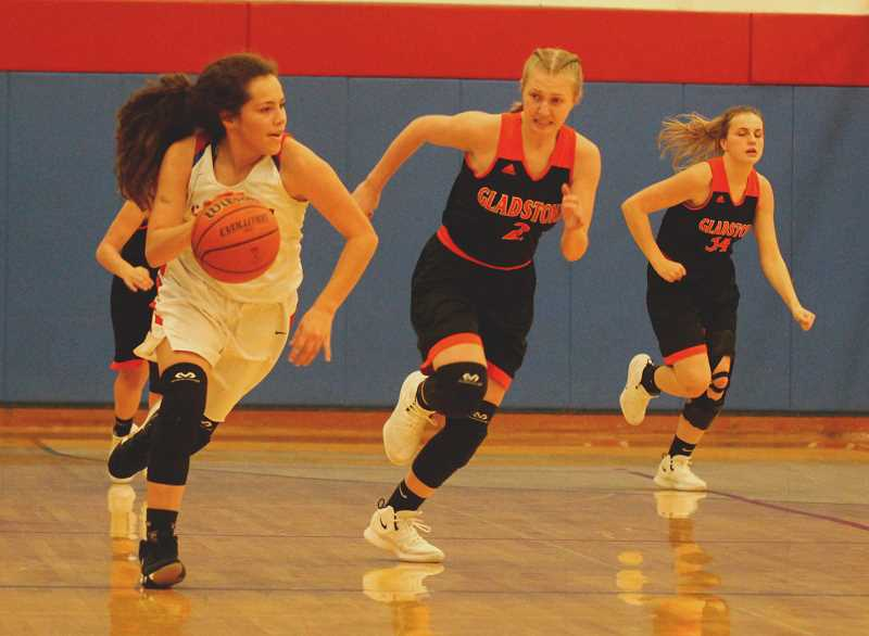STEELE HAUGEN - Jayden Davis runs a fast break transition offense during the Lady Buffs' 70-54 win over Gladstone. Davis led the White Buffalos with 25 points Jan. 22.