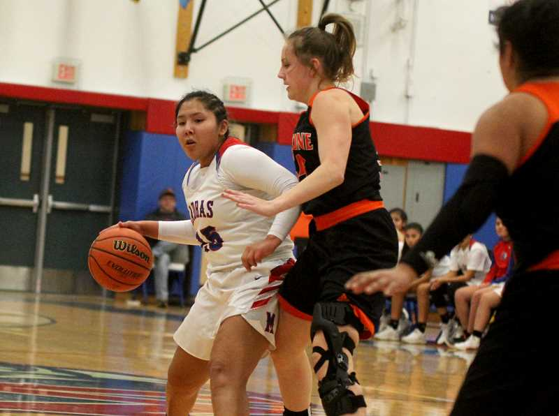 STEELE HAUGEN - Jiana Smith-Fancis dribbles by a Gladstone defender, while looking for an open teammate.