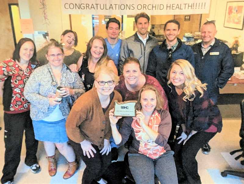 CONTRIBUTED PHOTO - Orchid Health employees show off their 2018 school-based health clinic excellence award from the Oregon Health Authority.