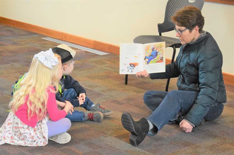 ESTACADA NEWS PHOTO: EMILY LINDSTRAND - Children enjoy a storytime during the signup event for the Dolly Parton Imagination Library on Saturday, Jan. 26.