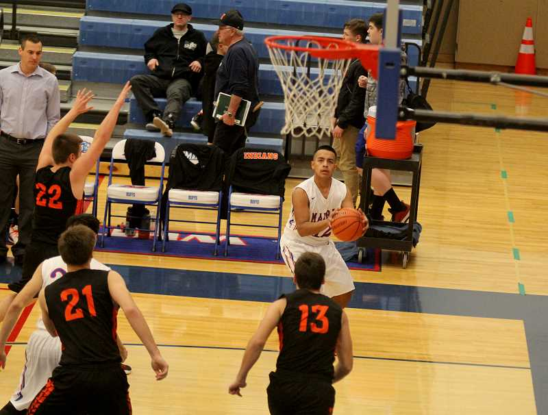 STEELE HAUGEN - Amial Rhoan lines up a shot in the corner of the 3-point line.
