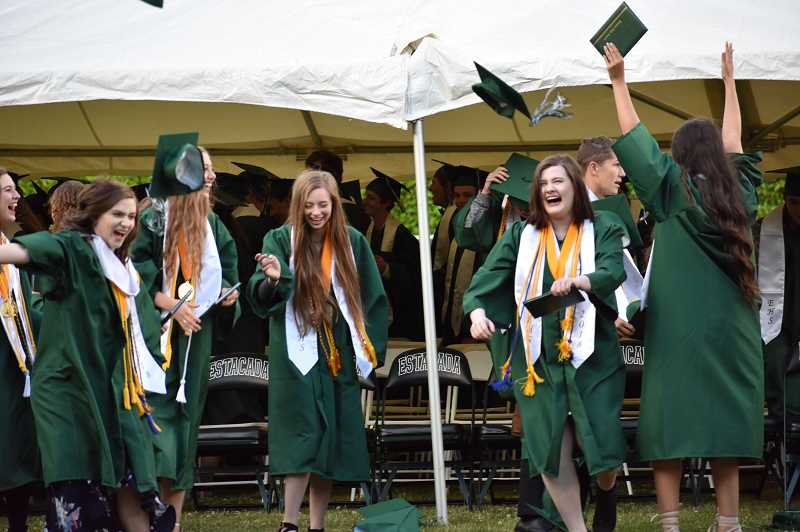 FILE PHOTO - Graduates of the Estacada High School Class of 2018 are triumphant at the end of their commencement ceremony. Data from the Oregon Department of Education shows that the school's graduation rates are on the rise.