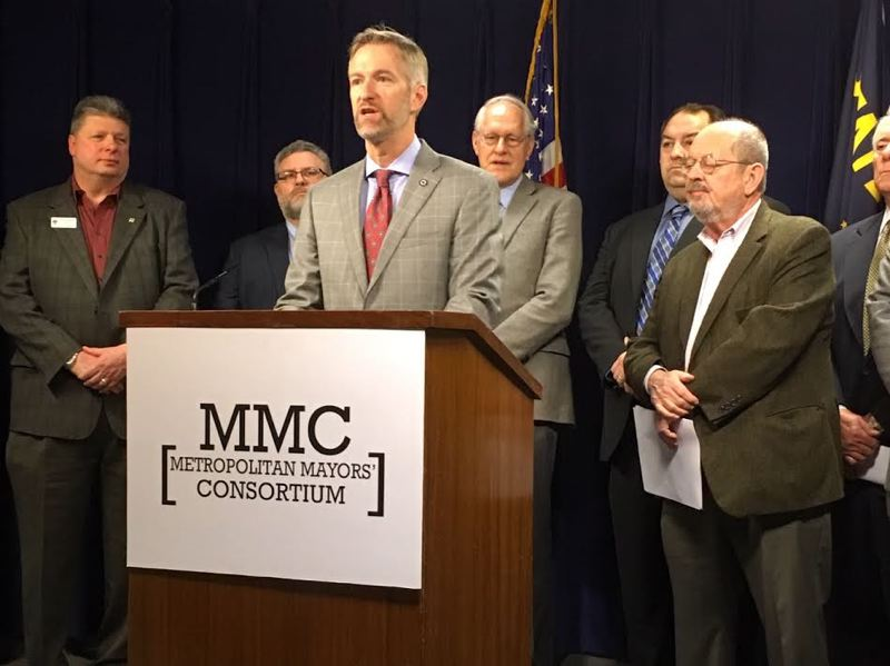 PAMPLIN MEDIA GROUP: PETER WONG - Portland Mayor Ted Wheeler, center, at Salem press conference Tuesday, Jan. 29, on priorities for metro area mayors in the 2019 Oregon Legislature. Others from left are Frank Bubenik, Tualatin; Jason Snider, Tigard; Tim Knapp, Wilsonville; Brian Hodson, Canby; Denny Doyle, Beaverton.