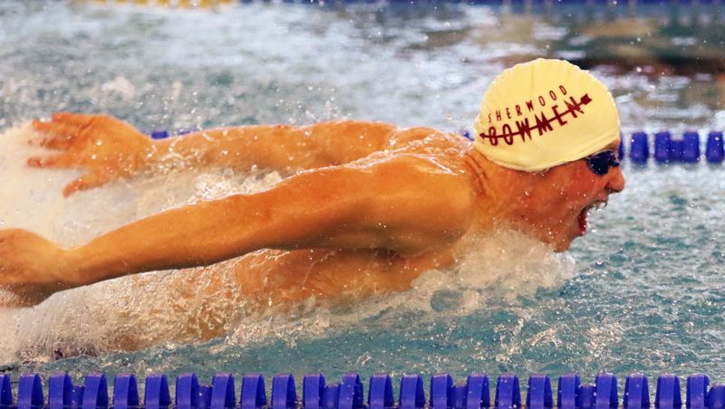TIMES PHOTO: DAN BROOD - Sherwood junior Jacob Folsom is on his way to victory in the 200-yard individual medley during Tuesday's meet at Newberg. Folsom holds the school record in the event.