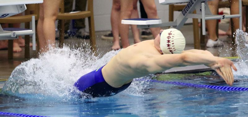 TIMES PHOTO: DAN BROOD - Sherwood senior Sam Ettelstein takes off in the 100 backstroke event at Tuesday's meet. Ettelstein won the race in a time of 1:00.03.