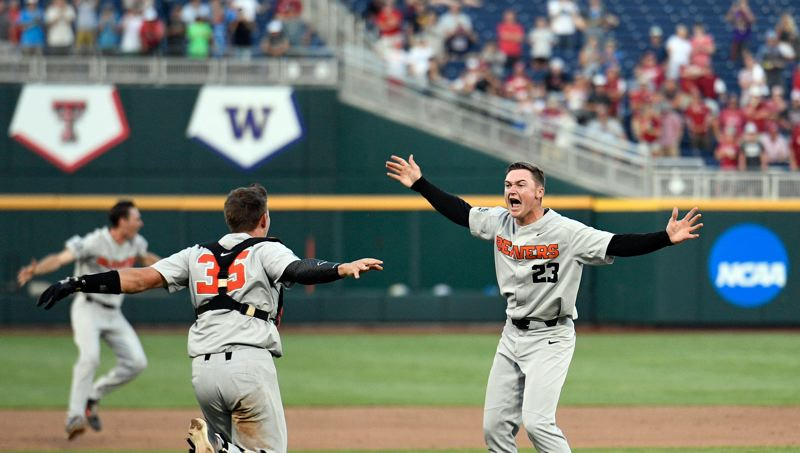 COURTESY: OREGON STATE UNIVERSITY - Kevin Abel (right) and catcher Adley Rutschman celebrate last year with the College World Series champion Oregon State Beavers.