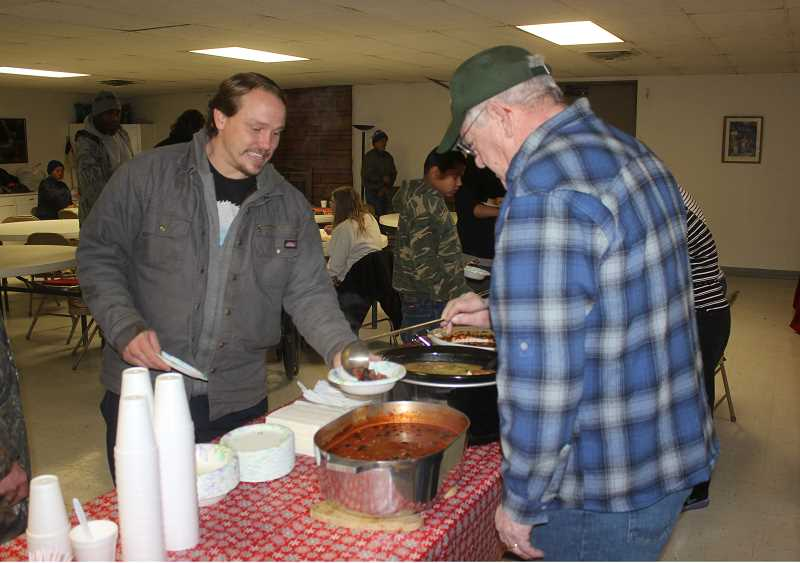DESIREE BERGSTROM/MADRAS PIONEER - Volunteers serve soup to those attending the Point-in-Time Homeless Count.