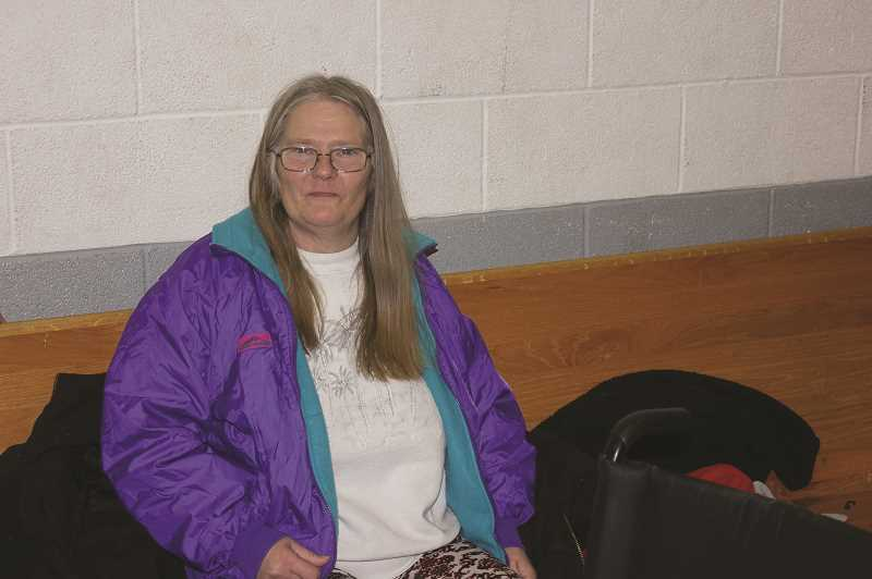 DESIREE BERGSTROM/MADRAS PIONEER - Danette Walleln selected a new coat the the Point-in-Time count and resource fair after having lunch.
