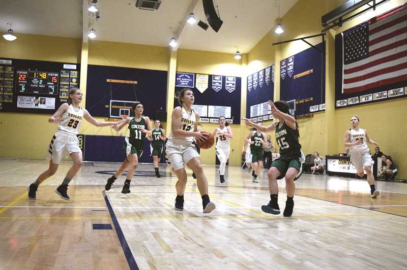 PIONEER PHOTO: TANNER RUSS - Country Christian senior Sarah Phillips drives to the hoop in the Cougars 54-45 victory over neighboring Colton.