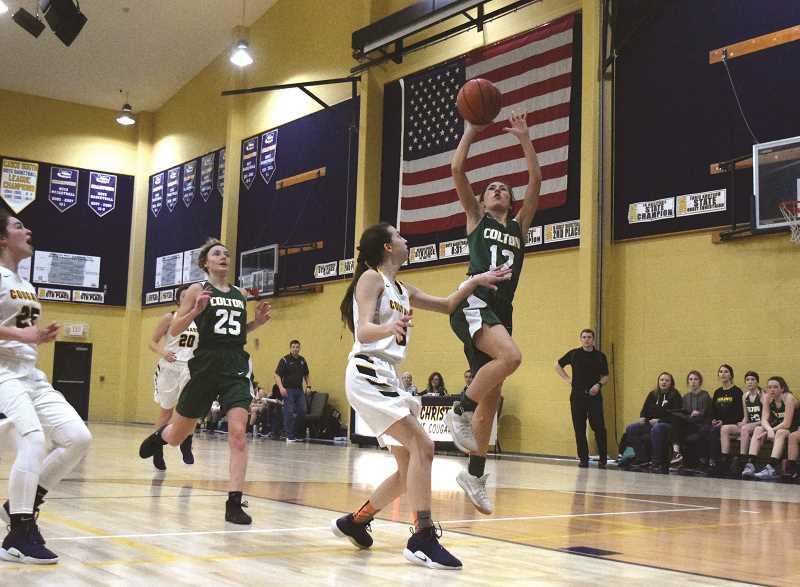 PIONEER PHOTO: TANNER RUSS - Colton senior Kaelie Gates shoots the fadeaway jumper over Country Christian defenders.