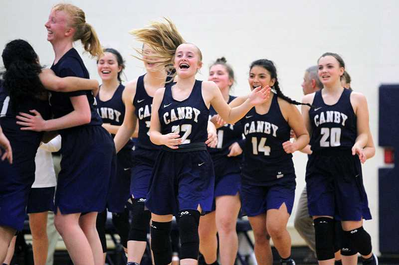 PAMPLIN MEDIA GROUP PHOTO: MILES VANCE - Canby celebrates after its second league victory over the Lake Oswego Lakers.
