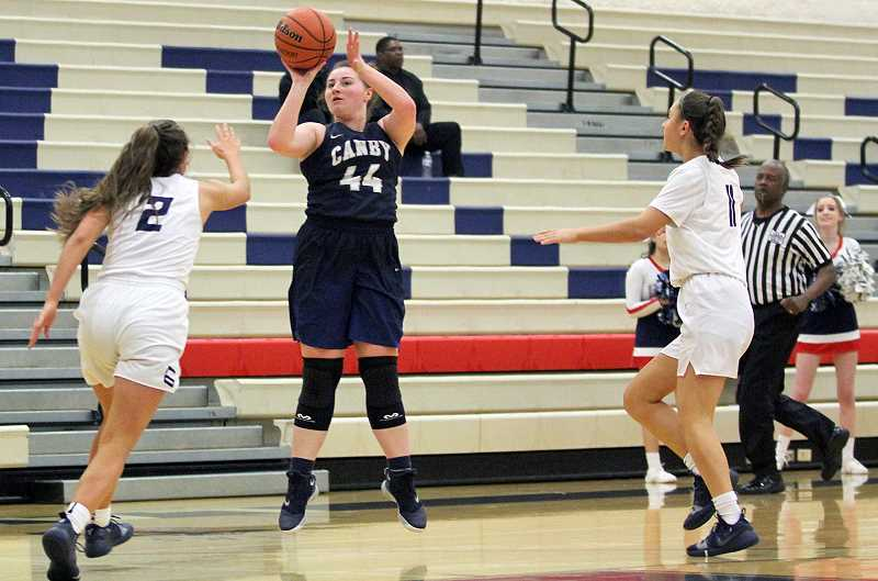 PAMPLIN MEDIA GROUP PHOTO: MILES VANCE - Canby senior Amanda Davis pulls up for the jumper against Lake Oswego.