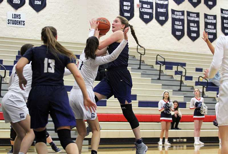 PAMPLIN MEDIA GROUP PHOTO: MILES VANCE - Canby junior Nicole Mickelson drives to the hoop against the Lakers in the 77-75 triple overtime victory.