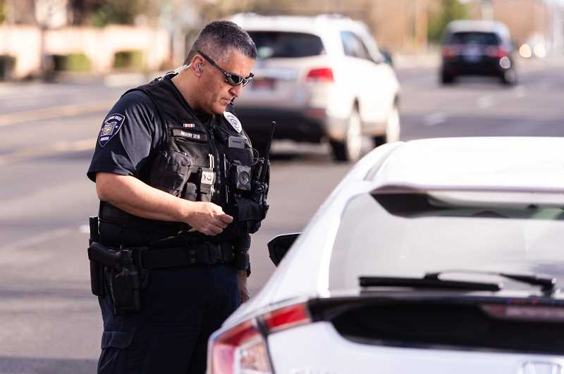 STAFF PHOTO: CHRISTOPHER OERTELL - Hillsboro Police Officer Anthony Silva speaks to a driver he pulled over for speeding along E. Main Street. Silva is one of two new traffic officers brought on to expand the citys traffic team.