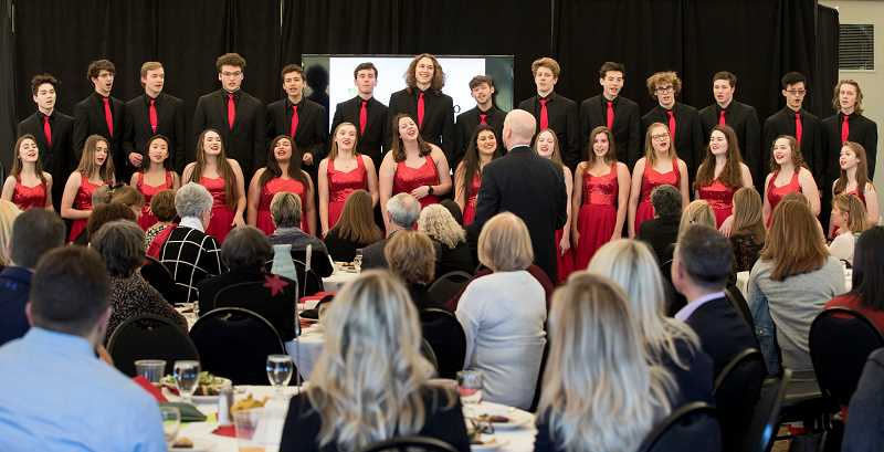 REVIEW PHOTO: JAIME VALDEZ - Lakeridge High School's Company entertains the crowd Tuesday at the Lake Oswego Schools Foundation's annual luncheon. Lake Oswego High's Windjammers also performed at the event.