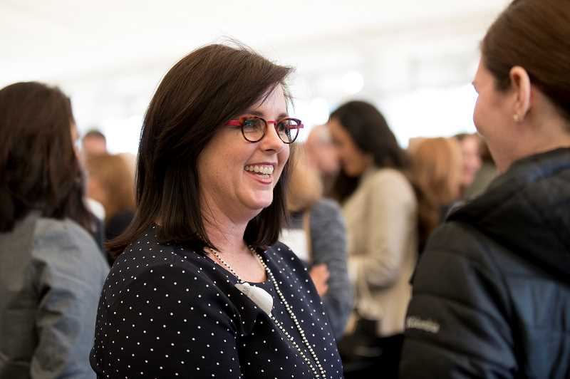 REVIEW PHOTO: JAIME VALDEZ - Foundation Executive Director Mary Kay Larson mingles with attendees at Tuesday's luncheon. 'I've never met a group of people more dedicated to making sure we move the needle for our students,' she said.