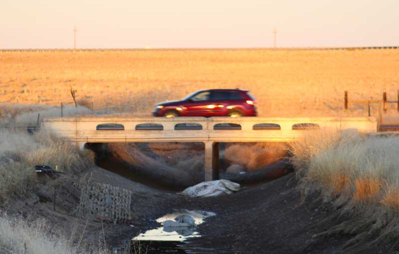 HOLLY M. GILL/MADRAS PIONEER - A car passes over the North Unit irrigation canal bridge on U.S. Highway 26, just north of Cherry Lane. The bridge is scheduled to close to certain heavy trucks.