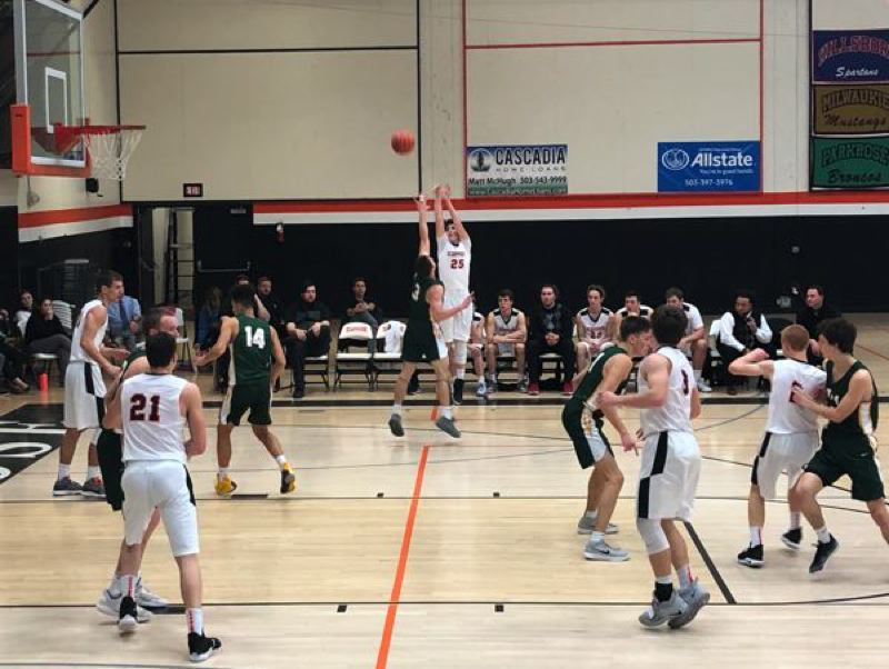 PAMPLIN MEDIA GROUP PHOTO: STEVE BRANDON - Sophomore Kyle Negelspach launches a 3-pointer for the Scappoose Indians and over his Putnam defender.