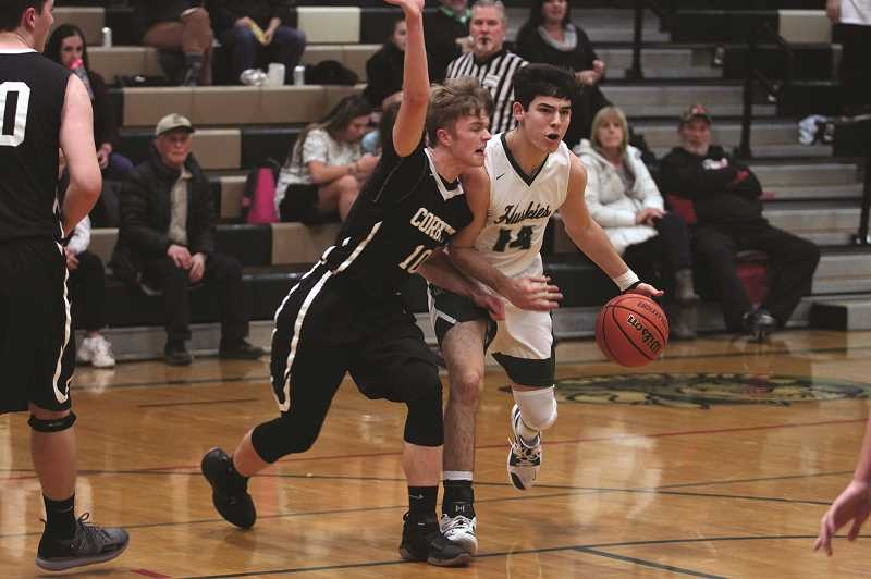 PHIL HAWKINS - North Marion senior Grant Henry attempts to drive past Corbetts Josh Newton in the first half of the Huskies 59-57 win over the Cardinals on Tuesday.