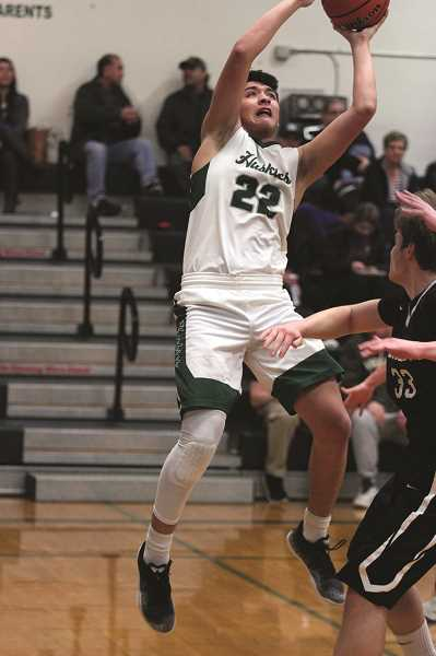 PHIL HAWKINS - North Marion junior Sergio Jimenez scored 12 points in the second quarter and finished with a game-high 24 to lead the Huskies to a 59-57 win over the Corbett Cardinals on Tuesday.