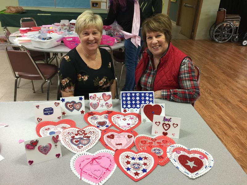 RSVP PHOTO - Volunteers gather in Scappoose to craft valentine cards for veterans during an annual service project on behalf of Columbia County RSVP. Pictured: Linda Bolen and Patsy Evert show off their creations for the Valentines for Vets event.