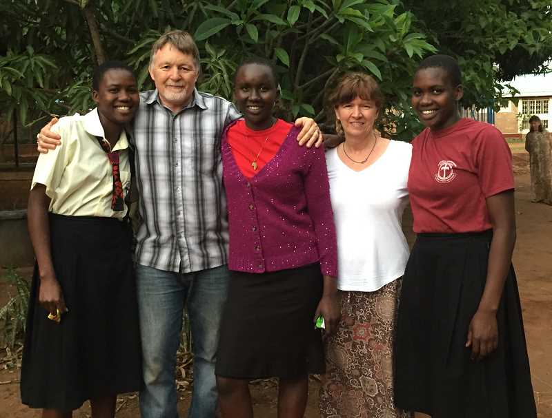 PHOTO COURTESY OF RUSS AND RHONDA RHODEN - This 2017 photos shows Russ and Rhonda Rhoden and their three Ugandan daughters that they sponsor. The youngest one just recently graduated from the Otino Waa school.