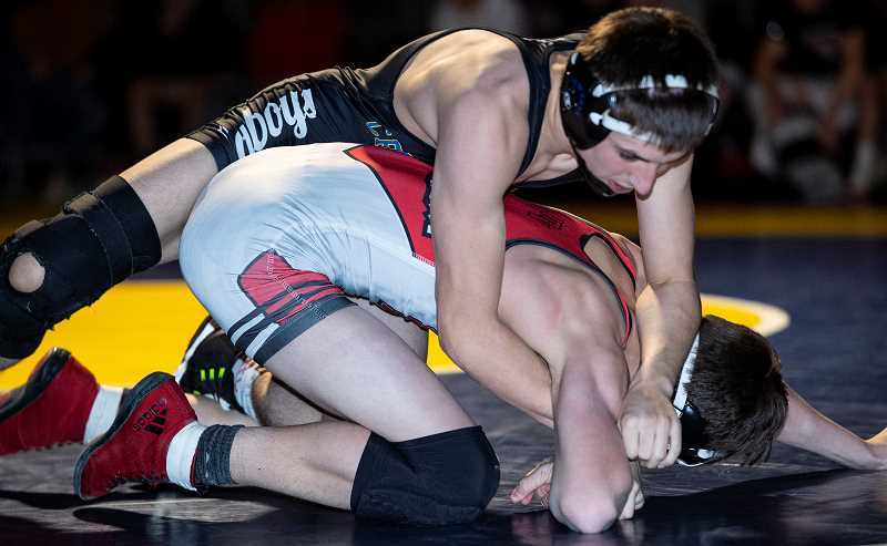 LON AUSTIN/CENTRAL OREGONIAN - Tannon Joyner works to control Caleb Potts in their 113-pound match Monday night as the Cowboys edged the Mountain View Cougars 37-31 in the final dual meet of the season for the Cowboys. Joyner went on to defeat Potts 5-2. The 113-pound match was the final match of the evening and clinched the dual meet win for the Cowboys.