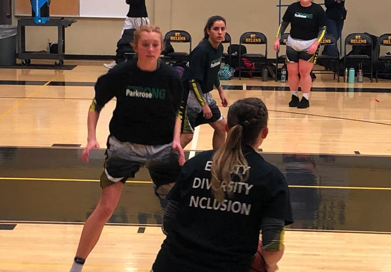 PMG PHOTO: STEVE BRANDON - Student athletes from St. Helens and Milwaukie high schools wear T-shirts on Jan. 25 prior to a girls basketball game. Students made the shirts in response to a series of racist comments that allegedly made on Jan. 15 when St. Helens played Parkrose High School.