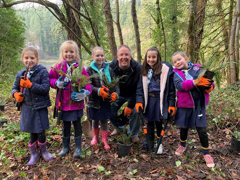 SUBMITTED PHOTO - City Councilor John Wendland joins Scouts from Pack 203 for a stewardship work party at Lily Bay Natural Area. From left: Ella Wennerth, Mia Jensen, Sarah Firmin, Wendland, Emma Leverton and Tatum Moore.