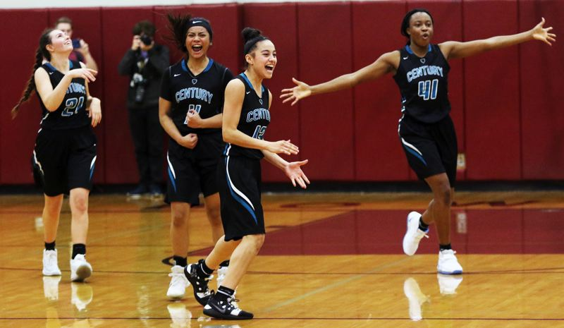 TIMES PHOTO: DAN BROOD - Century's (from left) Sarah Gruber, Janelle Maligaya, Angela Baltazar and Barakat Rahmon celebrate following the Jaguars' 27-26 win at Sherwood on Wednesday.