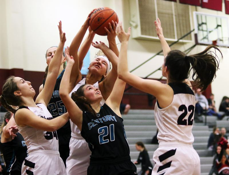 TIMES PHOTO: DAN BROOD - Sherwood players Cali Etherington (34), Kaytlin Cooke and Julia Leitzinger (22) and Century's Amy Walkenhorst (25) and Sarah Gruber (21) battle for a rebound during Wednesday's game.