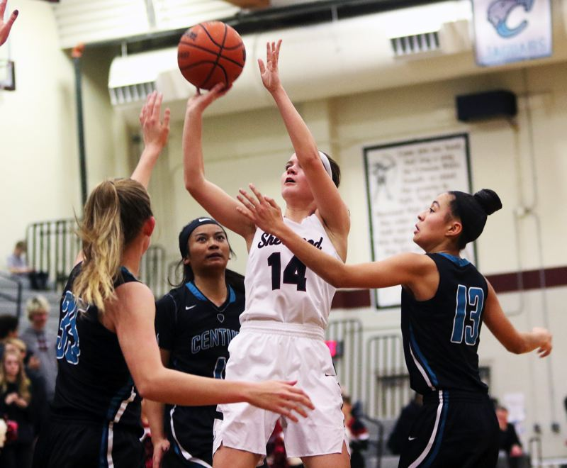 TIMES PHOTO: DAN BROOD - Sherwood senior Alex Verkamp, surrounded by Century players, shoots a jumper during Wednesday's Pacific Conference game.
