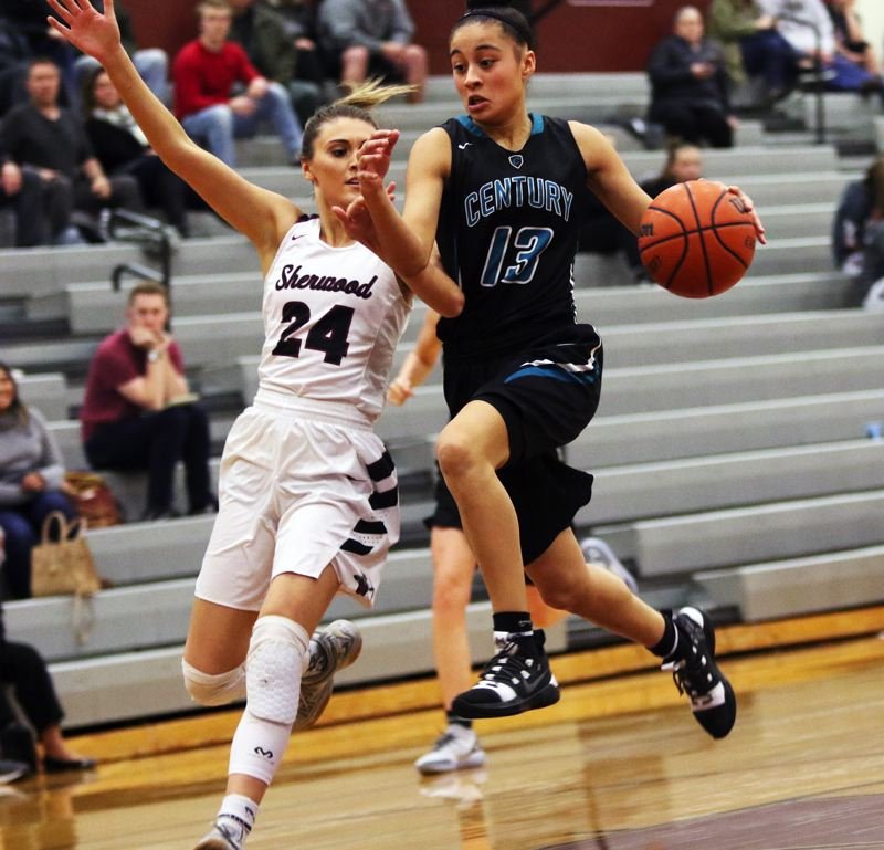TIMES PHOTO: DAN BROOD - Century junior Angela Baltazar (right) tries to drive to the basket against Sherwood senior Aubrie Emmons during Wednesday's game.