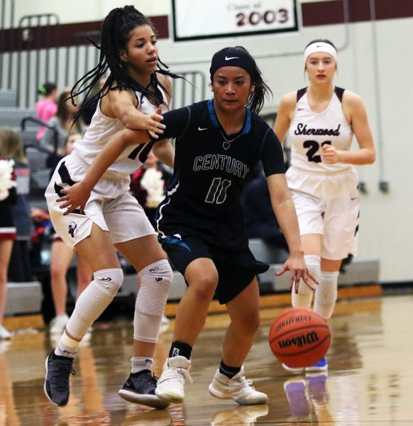 TIMES PHOTO: DAN BROOD - Century senior Janelle Maligaya (11) moves the ball up court against Sherwood sophomore Kylah Williams during Wednesday's game.