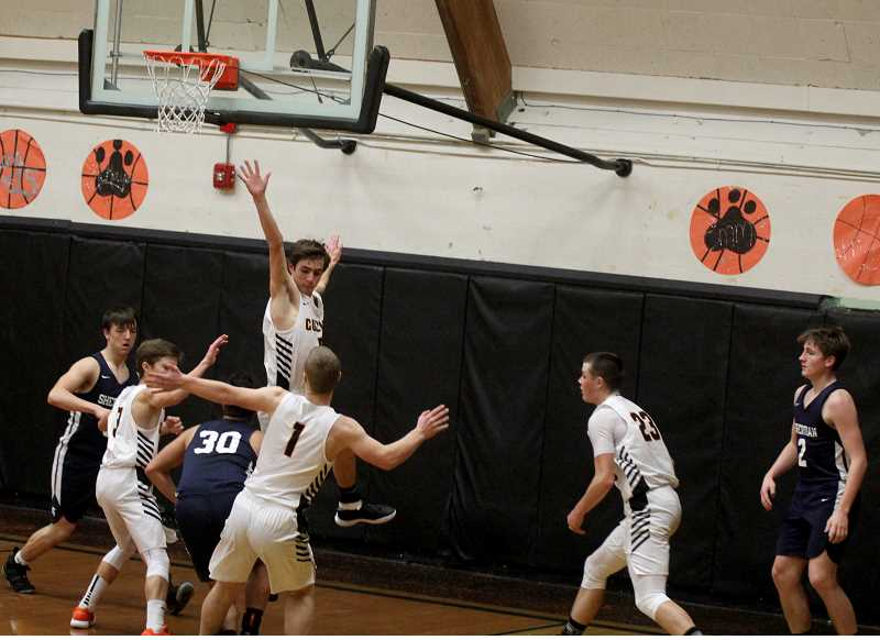 STEELE HAUGEN - A kennel of Bulldogs trap a Sheridan player during Culver's 83-33 loss Jan. 30.