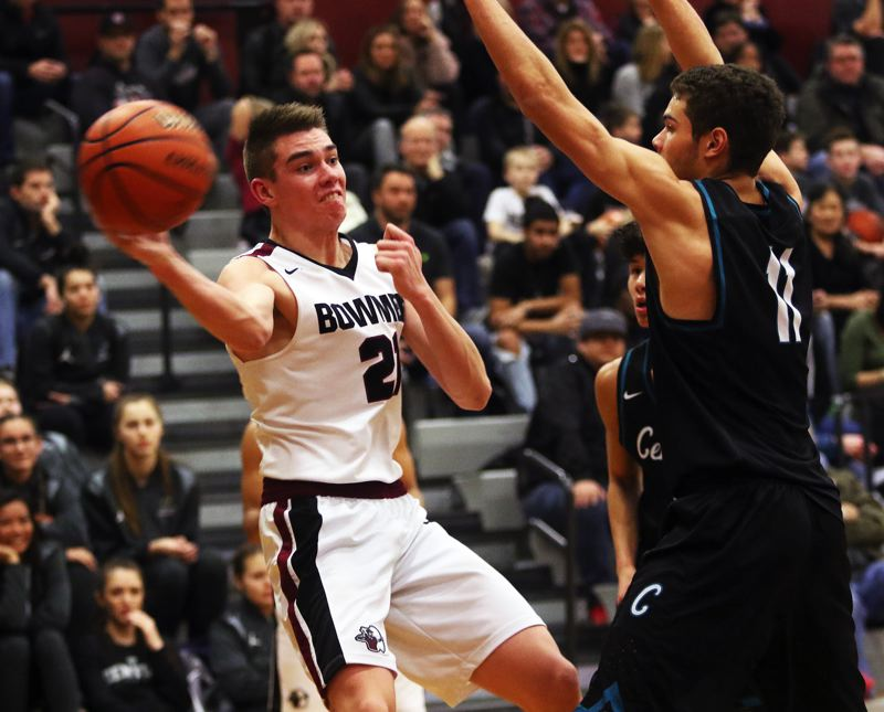 TIMES PHOTO: DAN BROOD - Sherwood High School senior Braden Thorn (left) looks to throw a pass from the baseline during the Bowmen's win over Century on Wednesday.