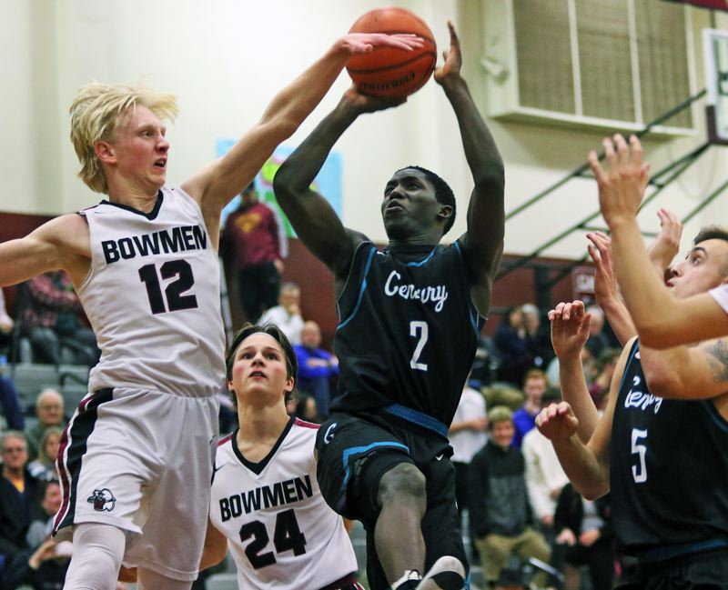TIMES PHOTO: DAN BROOD - Century junior Jospin Mugisha (2) goes up for a shot against Sherwood senior Cade Chidester during Wednesday's Pacific Conference game.