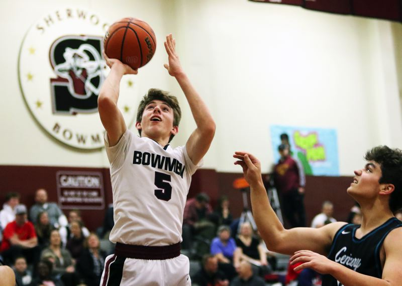 TIMES PHOTO: DAN BROOD - Sherwood junior Asher Krauel goes up to the hoop during the Bowmen's 70-50 win over Century.