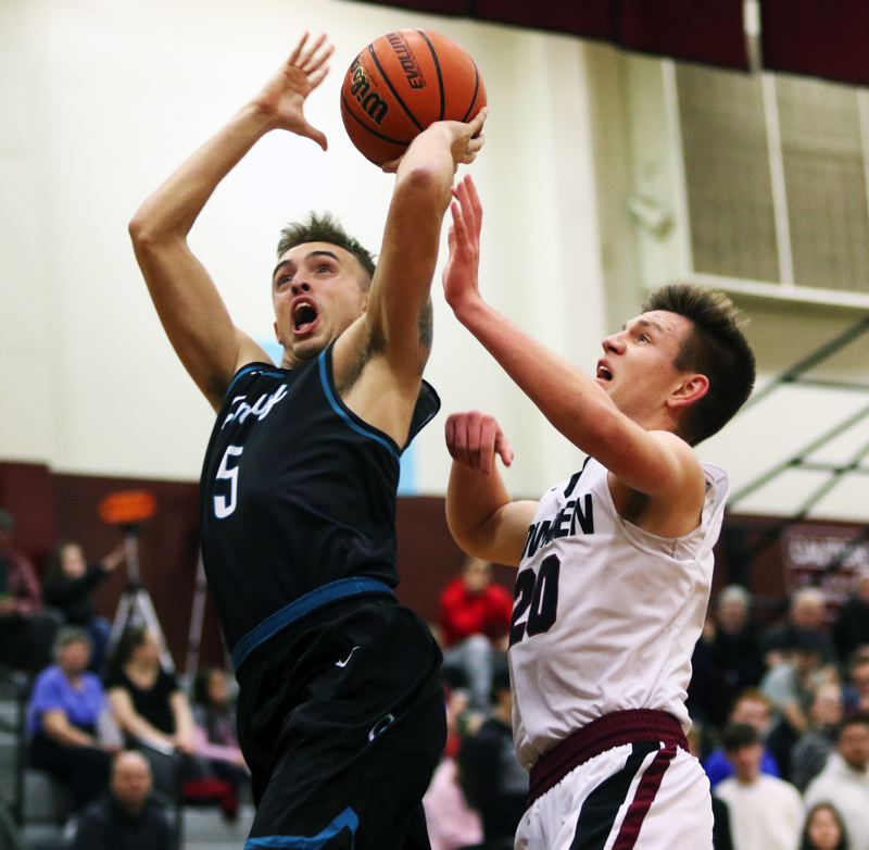 TIMES PHOTO: DAN BROOD - Century High School senior Preston Strauss (left) takes a shot during the Jaguars' game at Sherwood on Wednesday.