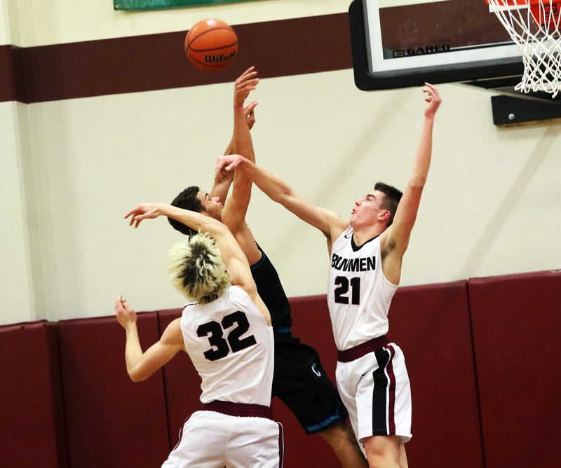 TIMES PHOTO: DAN BROOD - Sherwood High School senior Braden Thorn blocks a Century shot during the Bowmen's 70-50 Pacific Conference victory.