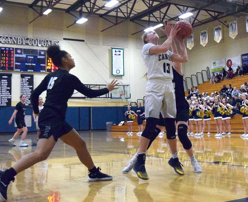 HERALD PHOTO: TANNER RUSS - Junior Ally Odell came alive in third quarter, scoring 8 points against a stiff Tigard defense.