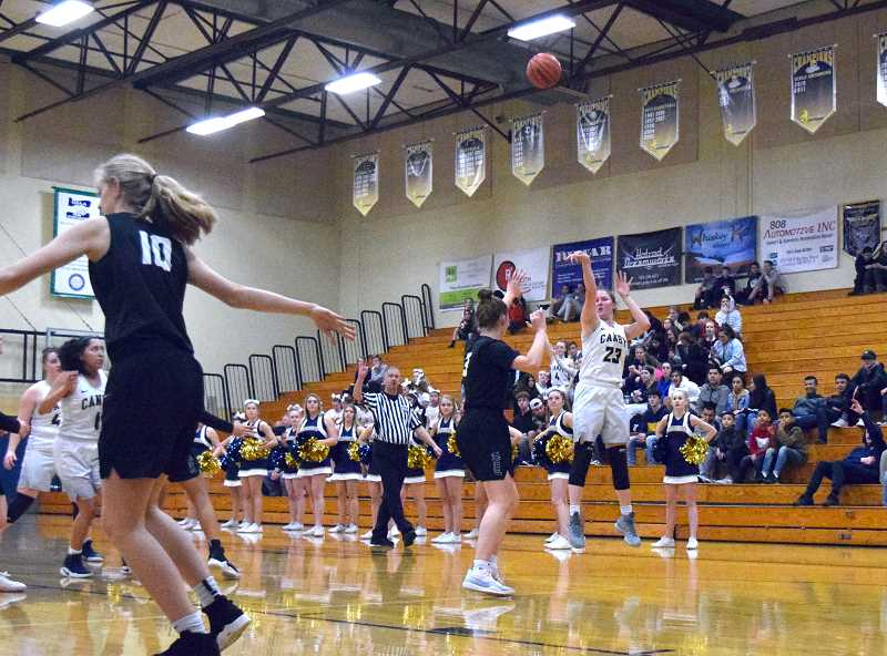 HERALD PHOTO: TANNER RUSS - Canby junior Nicole Mickelson started the game strong for the Cougars, scoring the first 8 points for the home team.