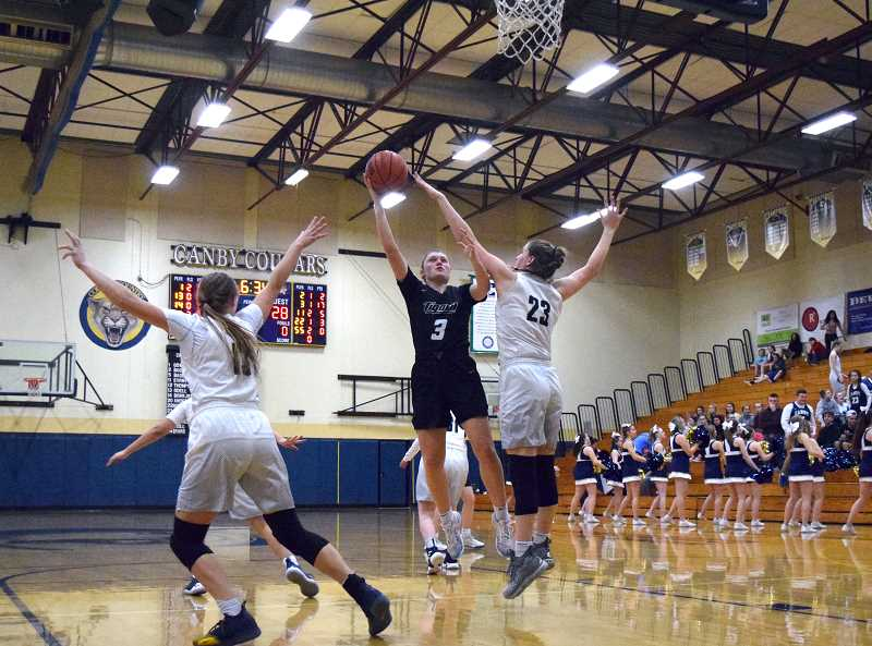 HERALD PHOTO: TANNER RUSS - Tigard senior Campbell Gray was on fire, scoring 29 points in the second meeting against Canby.