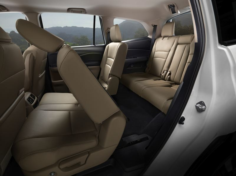 HONDA NORTH AMERICA - There is plenty of room in the second row of seats that can be ordered for twoor three passenger, although the thiurd row is best for children.